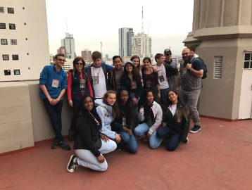 harvey students pose for a group shot on a rooftop in buenos aires