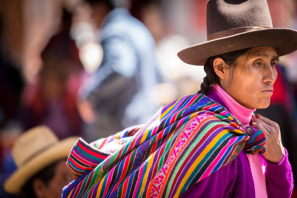 native Peruvian woman in traditional colorful dress